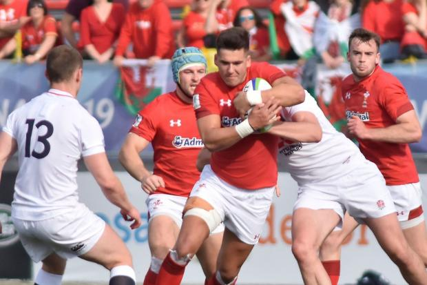 CARRYING HARD: Wales U20s centre Tiaan Thomas-Wheeler on the run against England (Picture: World Rugby)