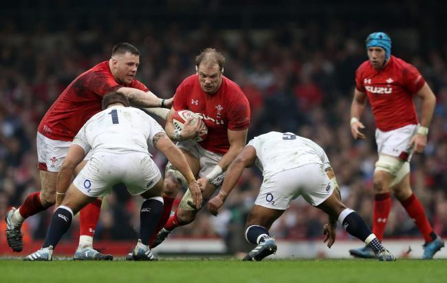 Wales' Alun Wyn Jones (centre) is tackled by England's Ben Moon (left) and Kyle Sinckler during the Guinness Six Nations match at the Principality Stadium, Cardiff. PRESS ASSOCIATION Photo. Picture date: Saturday February 23, 2019