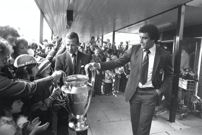 Nottingham Forest captain John McGovern (left) and keeper Peter Shilton (right) show supporters the European Cup at East Midland's Airport, after their 1-0 victory in the final over Hamburg in Madrid.
