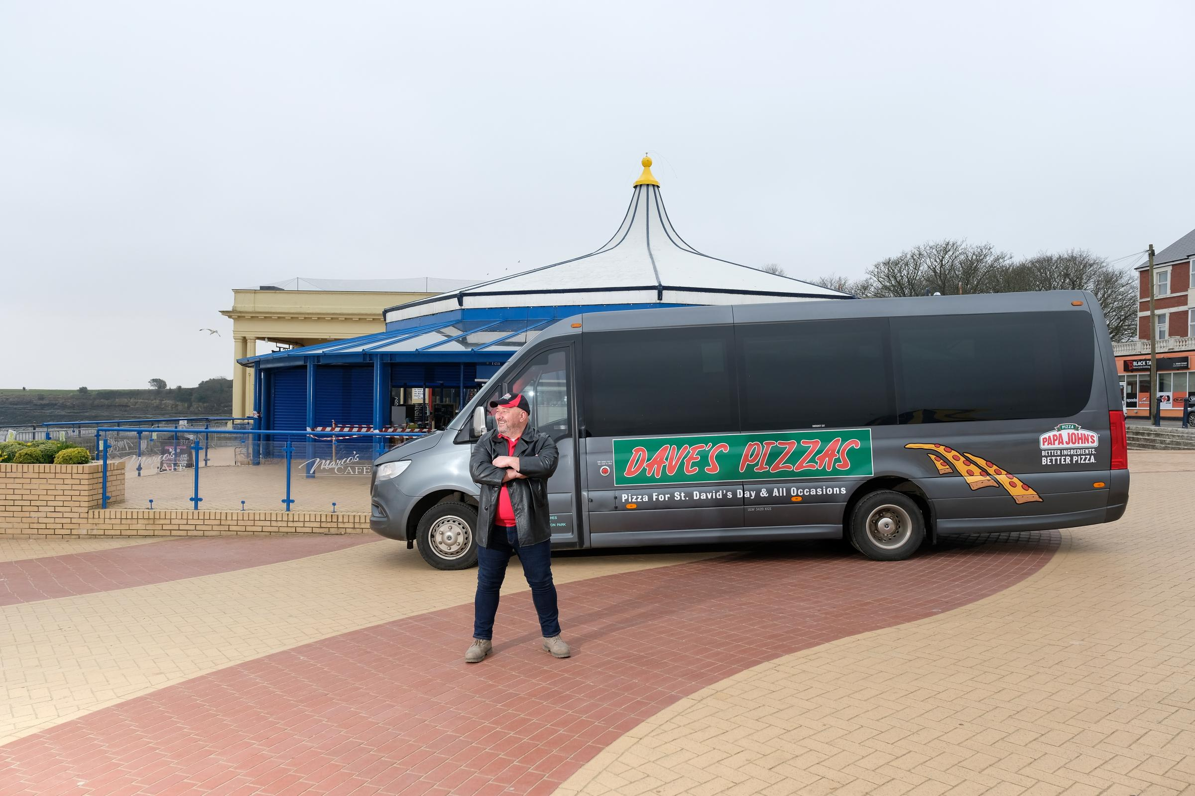 EDITORIAL USE ONLY Coach driver Dave from Barry, Wales launches Daves Pizzas delivery service, which has been set up by Papa Johns to celebrate St Davids Day. PA Photo. Picture date: Monday March 1, 2021. DaveÕs Pizzas, which is only ava
