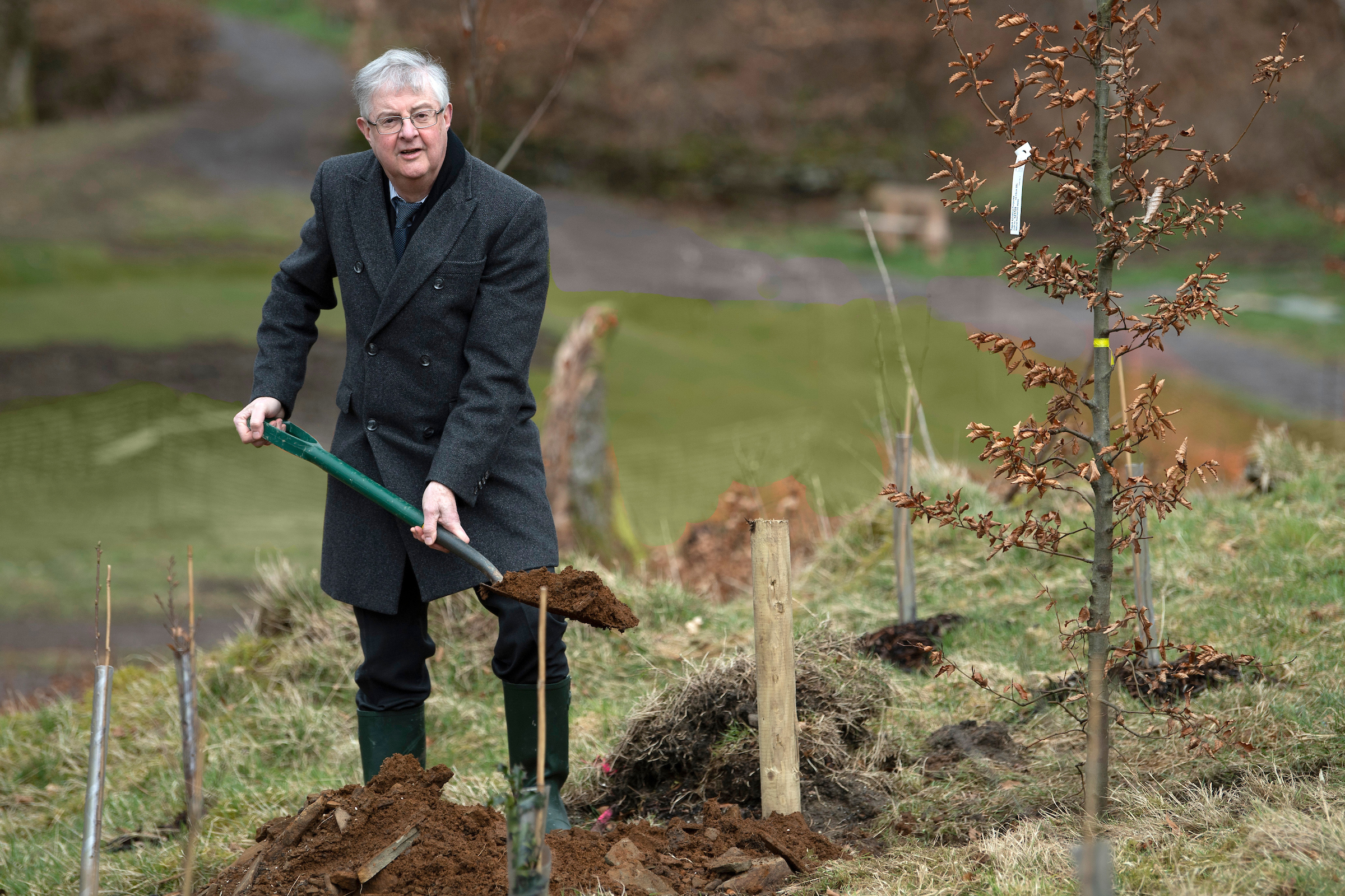 First Minister of Wales Mark Drakeford plants a tree in memory of those who have died of coronavirus at Cwmcarn Forest, Wales..