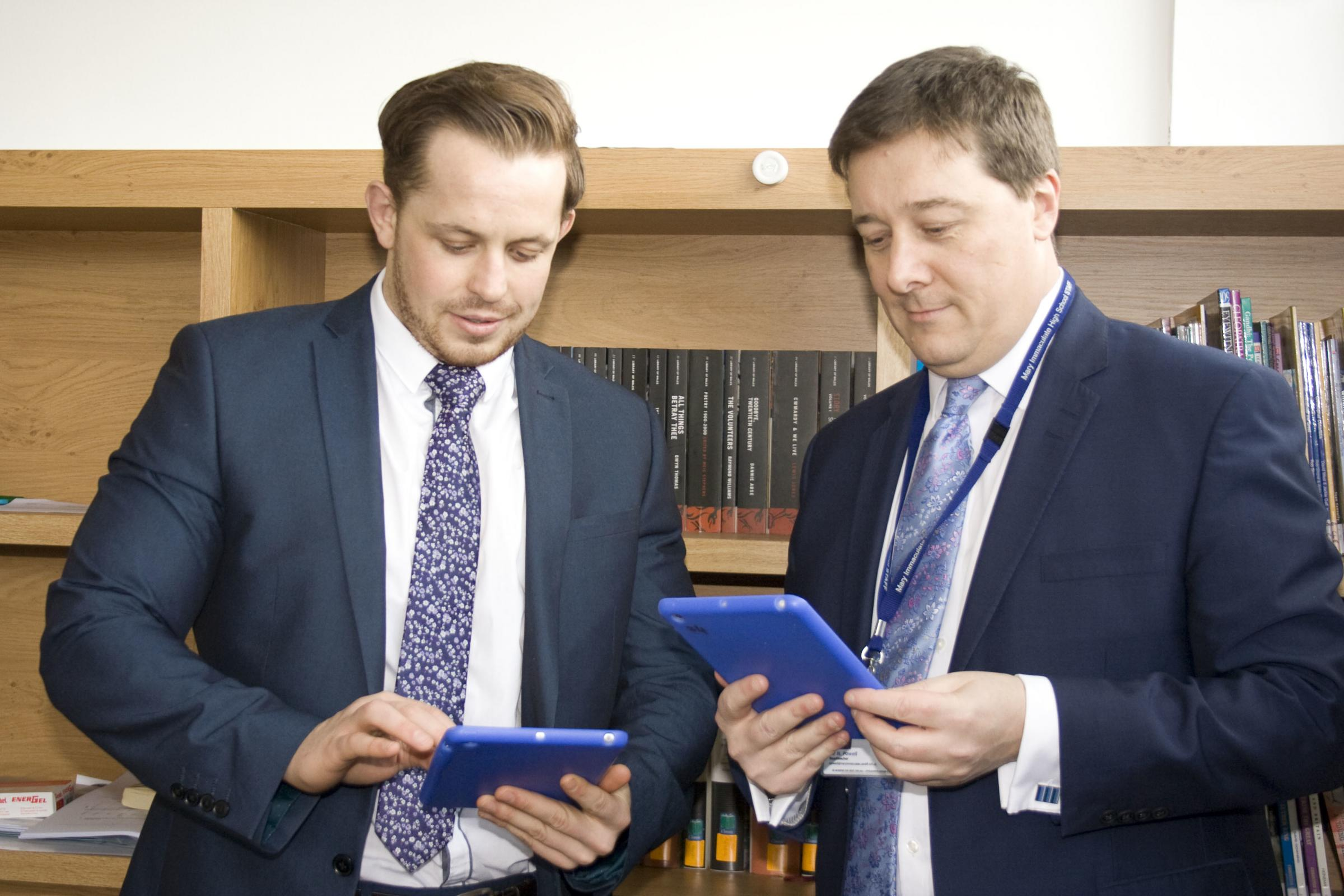 Mr Corcoran and Mr Powell try out the new technology