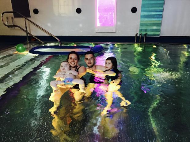 Barry And District News: Ollie and family in hydrotherapy pool