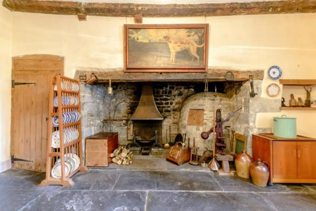 Barry And District News: This stunning fireplace is one of many historic features in Plas Llanmihangel. Picture: Savills Cardiff on Rightmove
