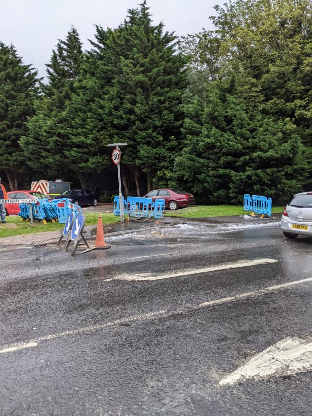 Barry And District News: The burst pipe is flowing onto nearby roads. Picture: Martin Chorley