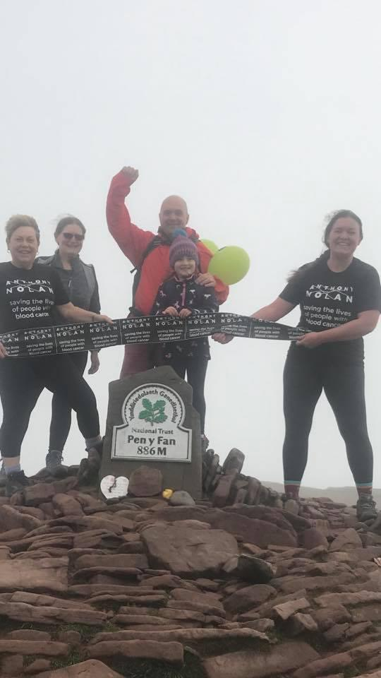 Barry And District News: Sophie Lewis (centre) with her family after conquering Pen y Fan