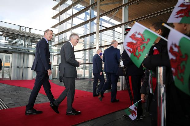 Barry And District News: First minister Mark Drakeford and Plaid Cymru leader Adam Price (left) arrive at the Senedd. Picture: Huw Evans Picture Agency