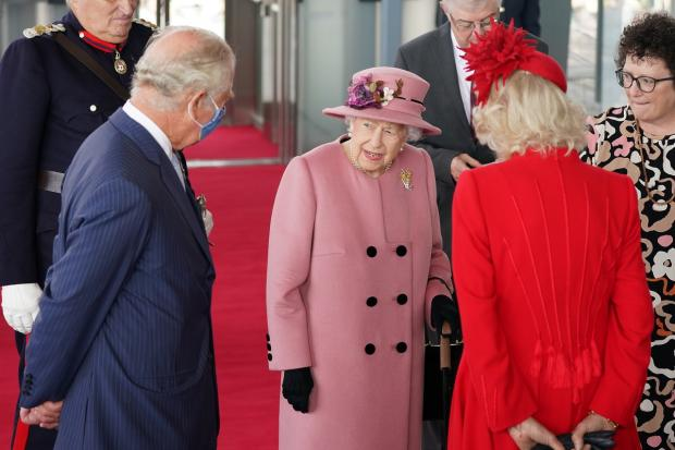 Barry And District News: The Queen speaks with the Prince of Wales and the Duchess of Cornwall before entering the Senedd. Picture: Jacob King/PA Wire