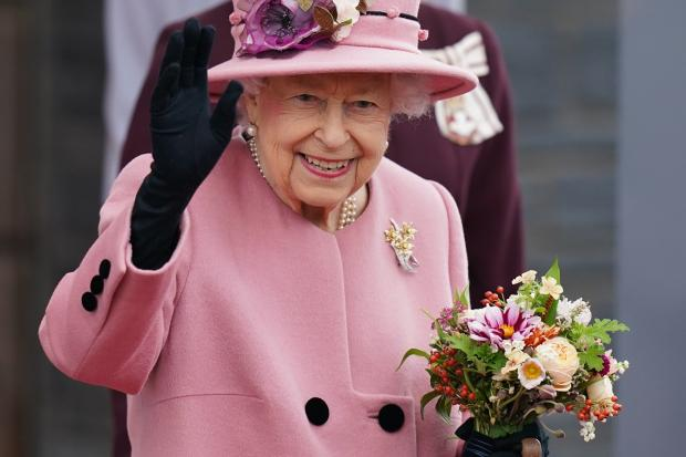 Barry And District News: The Queen waves to the crowd outside the Senedd after opening the sixth Welsh Parliament. Picture: Jacob King/PA Wire