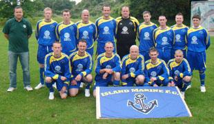 FOOTBALL: Manager Wayne Hopkins (left) with the Island Marine FC team.
