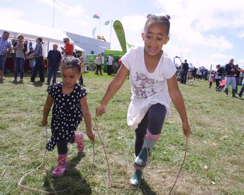 Lottie and Georgia of Barry, trying out the skipping ropes they made in the Vale Scouts tent.  Pictures: Roy Paul