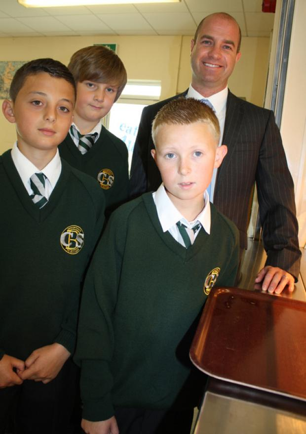 TOP CLASS: Year seven pupils make new headteacher Gerard McNamara feel welcome in the school restaurant.