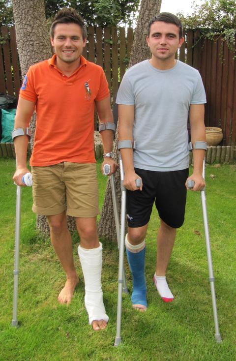 INJURED: Dan (left) and Lewis James at home.
