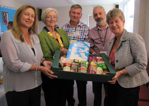 FOOD PARCEL: (from left) Susan Lloyd-Selby, Cllr Val Hartrey, Mike Grove, Dave Xerri and Jane Hutt AM.