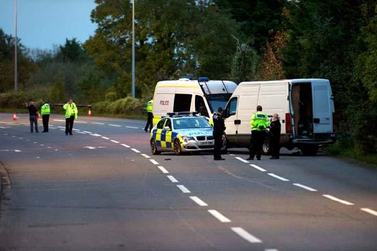 Police with the van, where it was seized near Penarth. Picture: Jo Nixon.