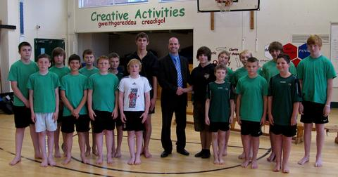 STUDENT-LED: Simon Sheppard, Mr McNamara and Liam Tanner with the gymnastics squad at their first training session.