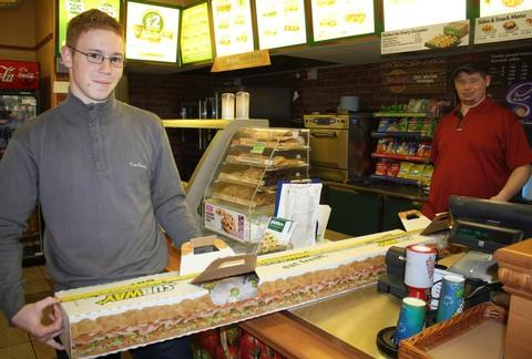 MADE TO MEASURE: Anthony Gent buys his 6ft sub from store manager Simon Locke.