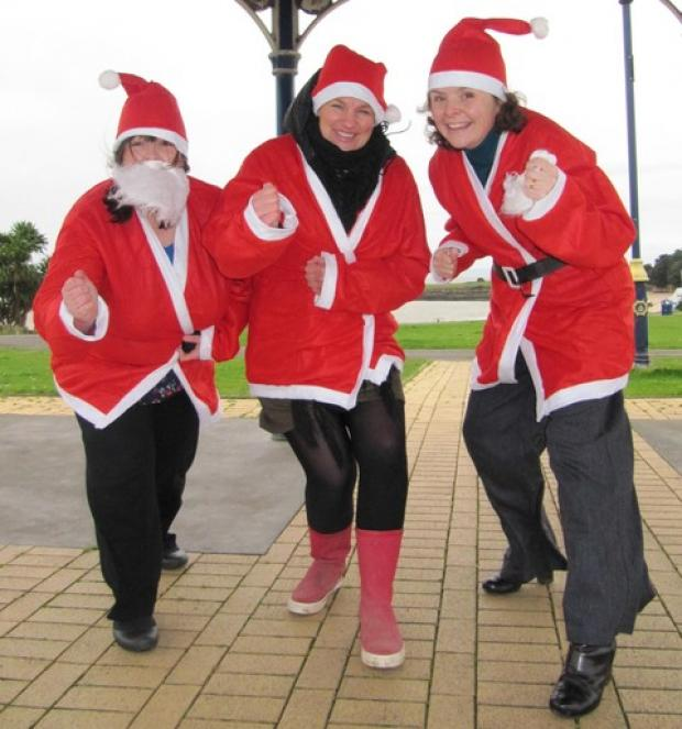 SANTA! (from left) Jayne Lewis, Sarah Jones and Meredith Gardiner gear up for the run.
