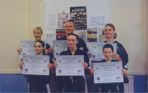 BLACK BELTS: All members of the Rising Phoenix Taekwon-Do Club, brother Tom Jones and sisters Rhian and Bethan Jones (front) and Paul and Tammy Nurse and Emily Gillingham were successful at a recent black belt grading.