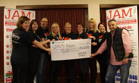 DONATION: Swimming World consultants (from left) Sarah Pryor, Annamarie Vincent, Steve 'Wiggy' Wiggins, Niki Evans, Lorraine Francis, Teresa Stewart, Nia Boulton and Joanne Evans, with Paul Adamson of the JAM Fund.