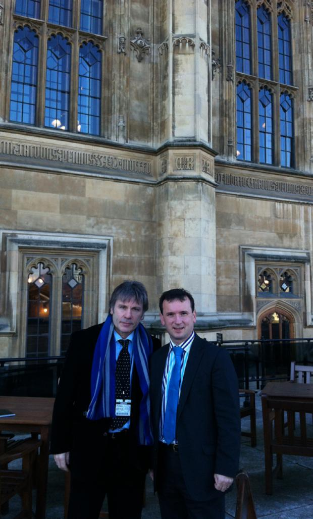 Bruce Dickinson with Vale MP Alun Cairns in Westminster.