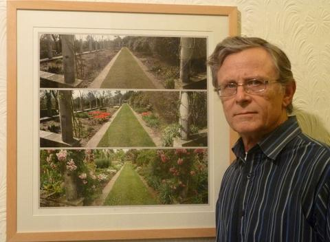 IN THE FRAME: Bernard van Lierop with a print of Dyffryn's Herbacious garden.