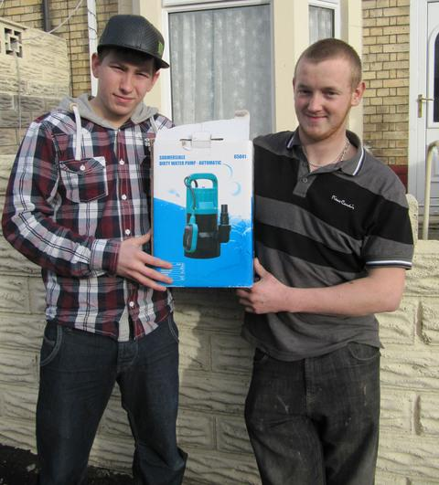 GOOD SAMARITANS: James Burniston (left) and Shane Statham bought a new pump for Barry Athletic Club.