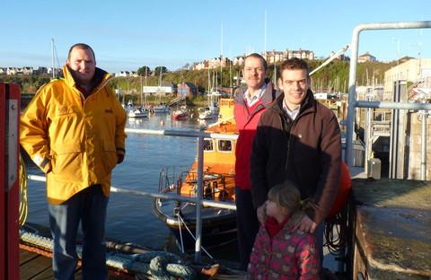 FUNDRAISER: Coxwain Hugh 'Spud' Davies with fundraisers Dave and Craig Stephen.
