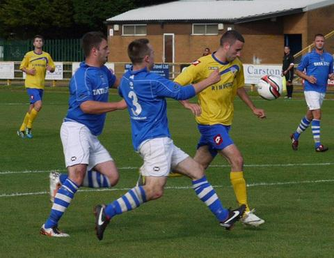 CHARGED UP: Barry Town duo (yellow tops) Lee Baldock (left) and TJ Nagi are set to lead the charge in Saturday's Welsh Cup clash with Pontardawe Town at Jenner Park (kick-off 2.30pm).
