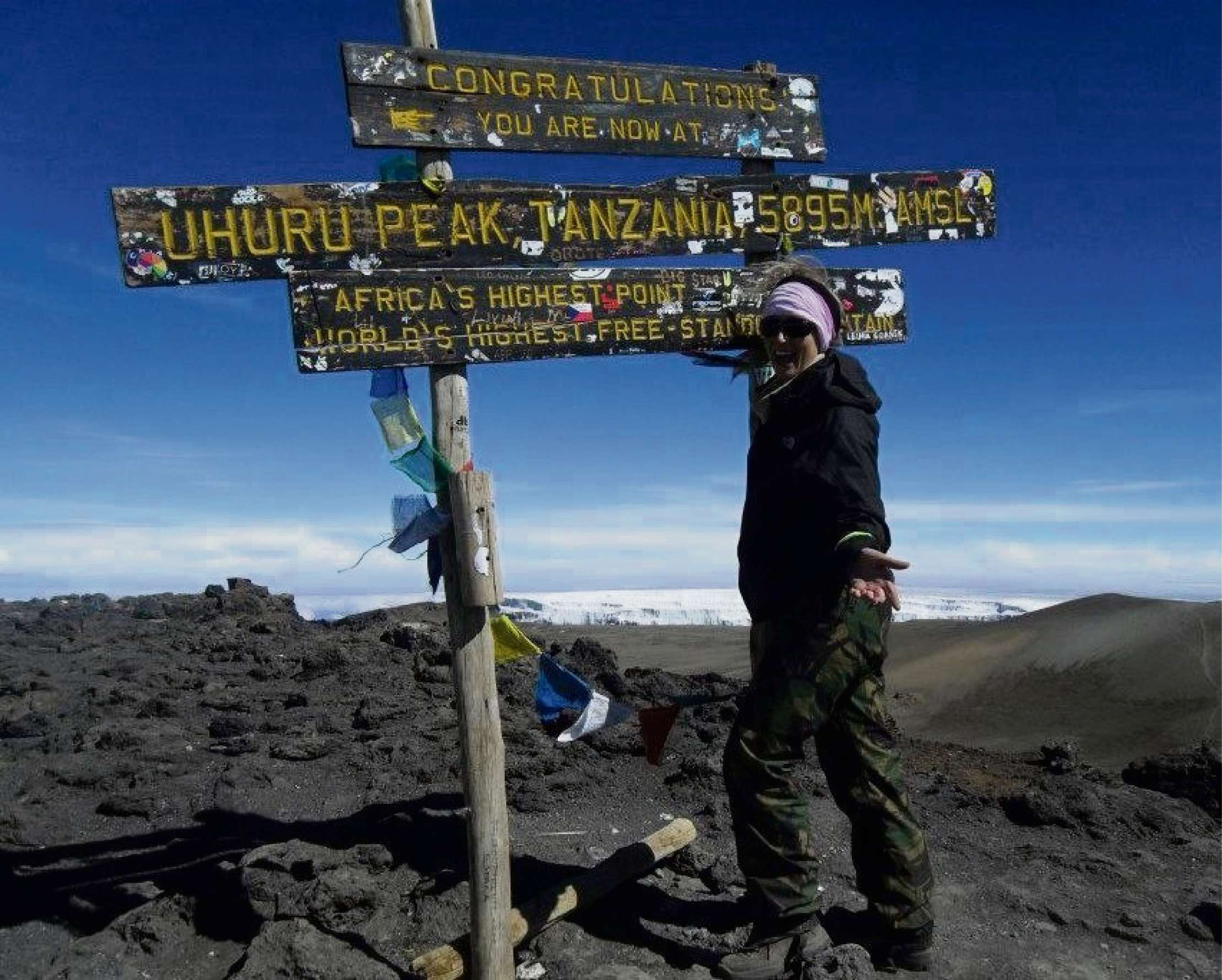 CHARITY: Naomi Clarke on top on Mount Kilimanjaro