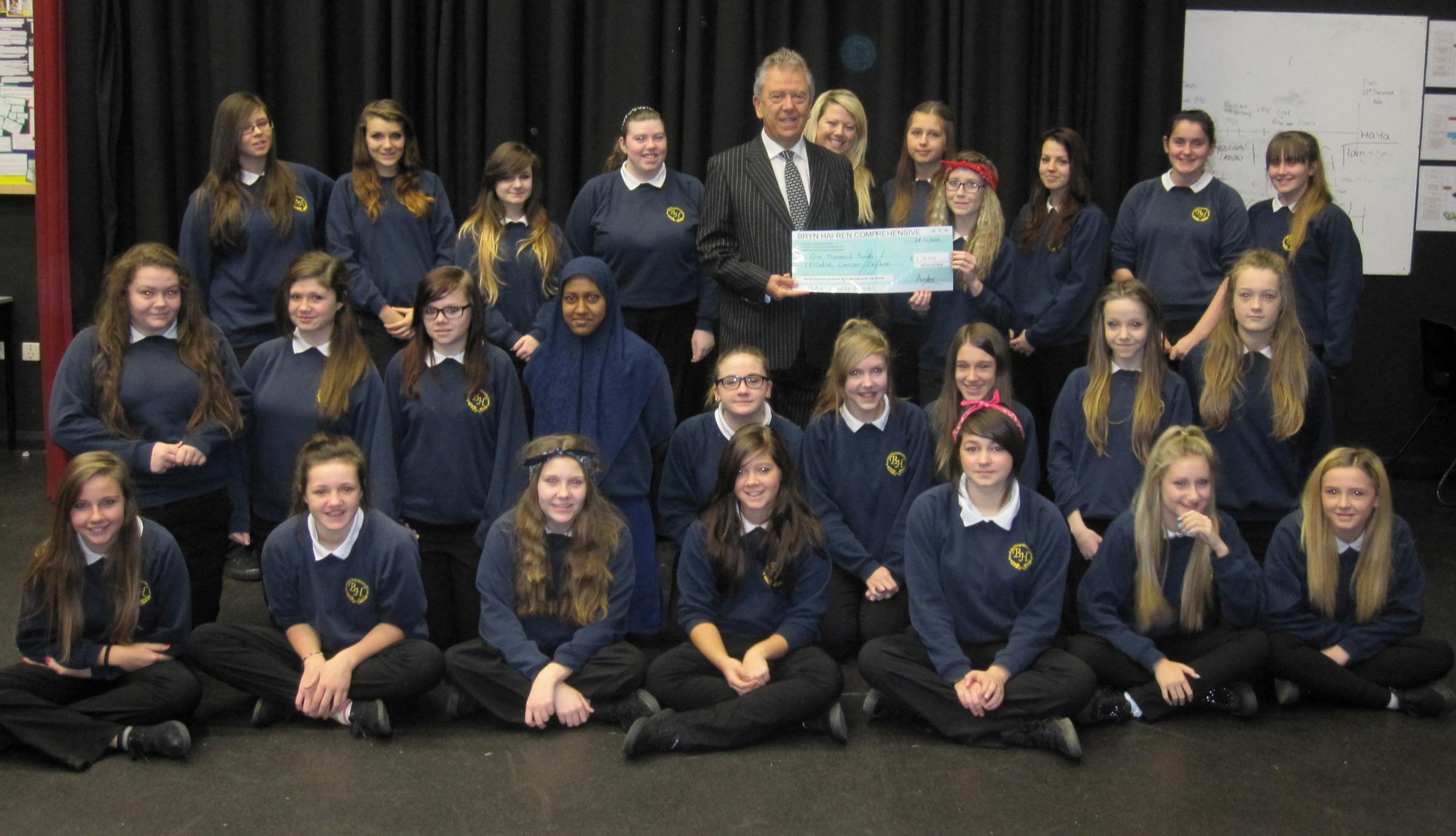 Recently year 9 have been celebrating the achievements of one of their forms, 9AX after they raised £1,000 for Velindre Cancer Care. The form decided to raise money after their form tutor Alexandra Williams found out her father Peter Williams was di