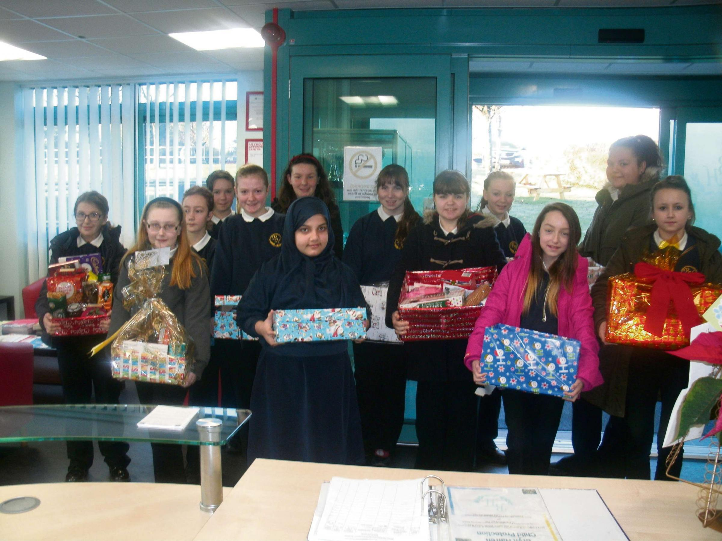READY FOR DELIVERY: Bryn Hafren pupils with their Christmas hampers
