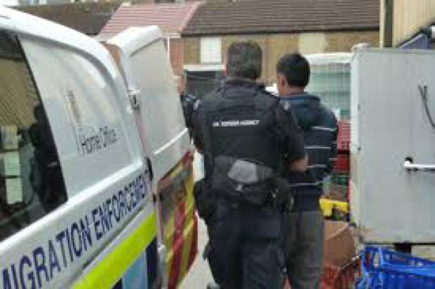HOME OFFICE: Immigration officers at work arrest a suspect
