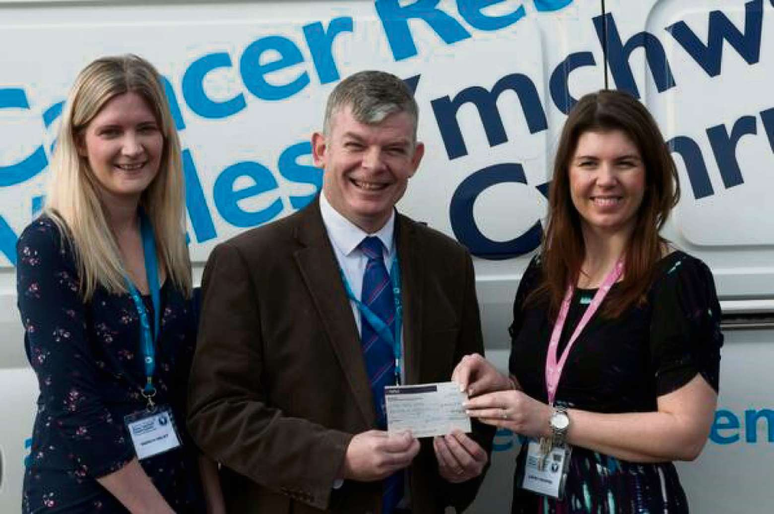 CHEQUE IN HAND: Sharon and Paul Haley, and Laura Hooper