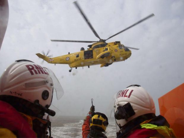SEARCH AND RESCUE: Barry Dock lifeboat and search and rescue helicopter on exercise last week