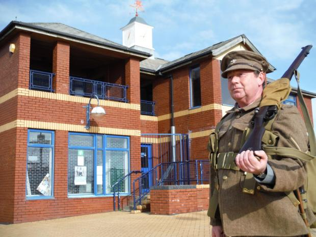 BARRY AT WAR: Historian Wayne Gill in front of the tourist information centre