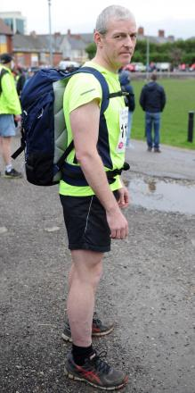 CHARITY RUN: Dinas Powys runner Martin Wade ran the Newport Half Marathon on Sunday in aid of Velindre Cancer Centre while carrying a 30lb pack on his back.
