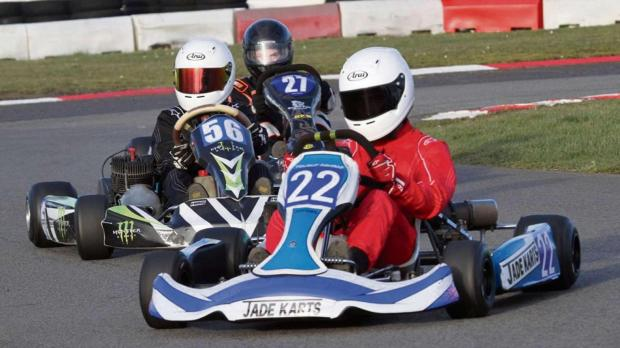 BATTLING KARTS: Reigning champion Yousuf Ashraf (22) does battle with Hugo Holmes (56) and Sam Johns in the Junior TKM final at Llandow Kart Club's opening meeting of 2014. Picture: Hardy Rodde.