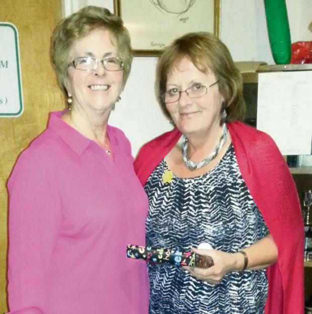 Barry And District News: WINNING SCORE: Jo Kirkpatrick (right) is congratulated on her St David's Day competition success at Brynhill Golf Club by lady captain Carole Bumford.
