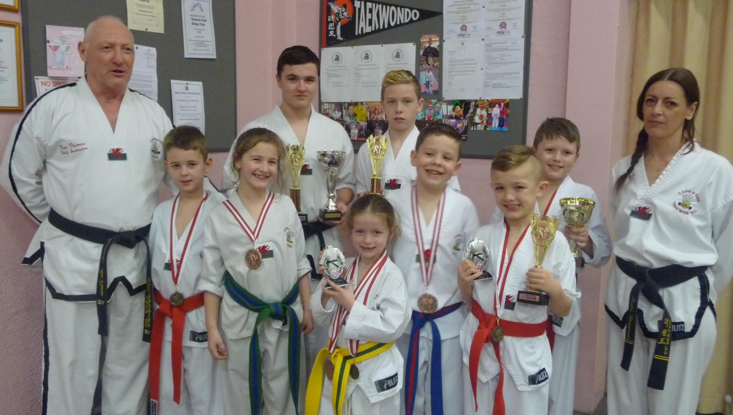 TOP STUDENTS: Cadoxton Schools of Taekwondo chief Ron Thomas (8th degree) with celebrating students - Bradley Halford, Thomas Haysham, Jake Quigley, Jessie Blackley, Maddison Allen, Joel Wells, Cian Allen and Cody Jacobsen.