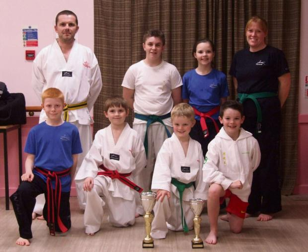 Barry And District News: CHAMPIONSHIP DISPLAYS: Students from Vale-based JSTKD Martial Arts & Fitness excelled at the recent English Taekwondo Championships in Worcester. Back row (from left): Chris Edwards, Ashton Curnick, Menna Burmingham and Lynne Doel. Front: Rhys Doel, J