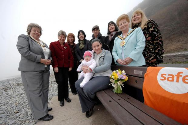 TRIBUTE: Mayor's consort Jayne Norman, Jane Hutt AM, Councillor Lis Burnett, Louise Mackintosh, Mark Dickenson, Glenys Dickenson, Bev Noon with Hannah and Matilda sitting on the bench