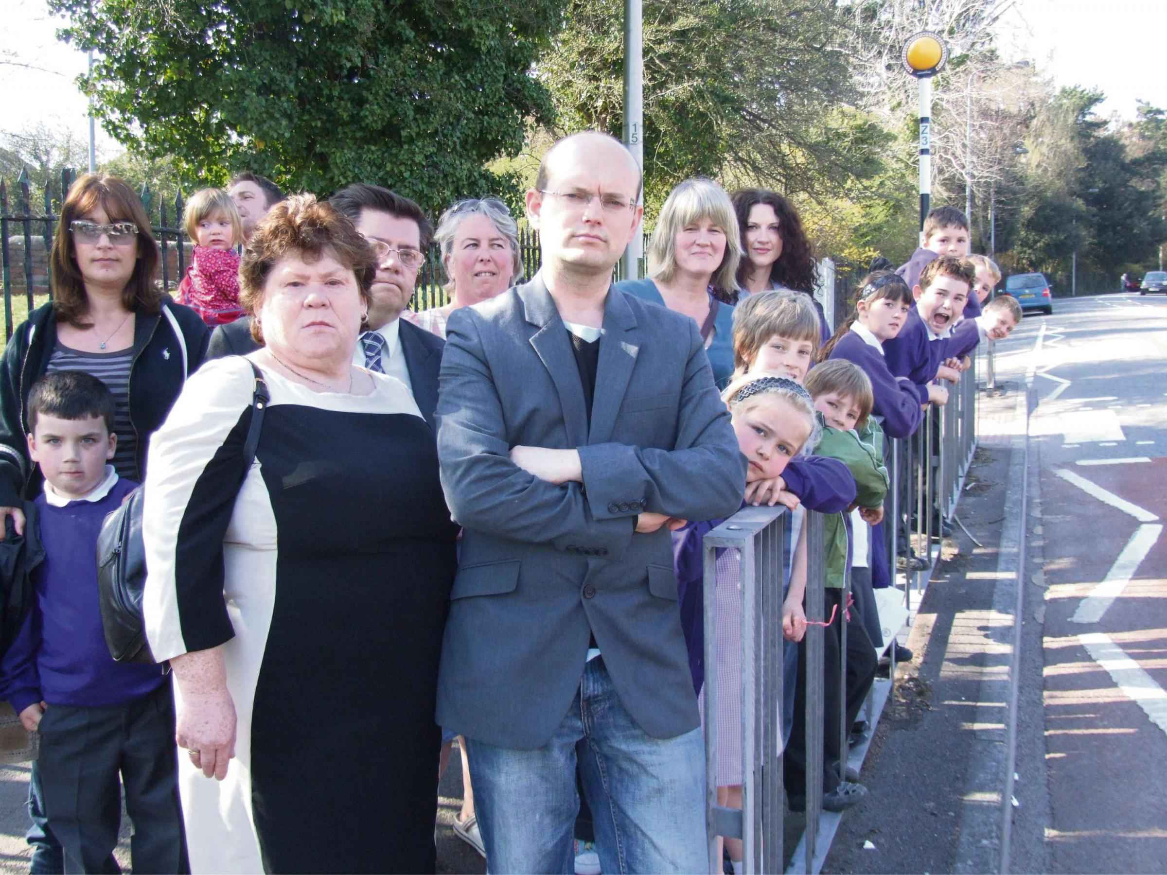 CAMPAIGN: Parents, residents and Councillor Ian Johnson on Buttrills Road in 2012