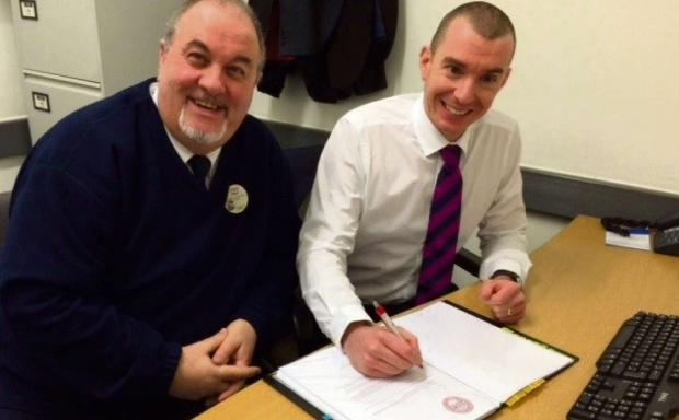 AGREEMENT: Business PACT chairman Dave Sharpe and Tesco general manager John Mitchell