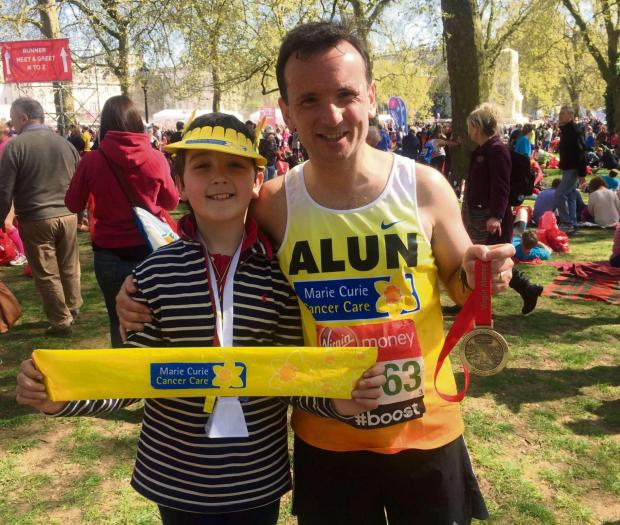 FOLLOW IN FOOTSTEPS Alun Cairns greeted by his son Henri on completion of his run