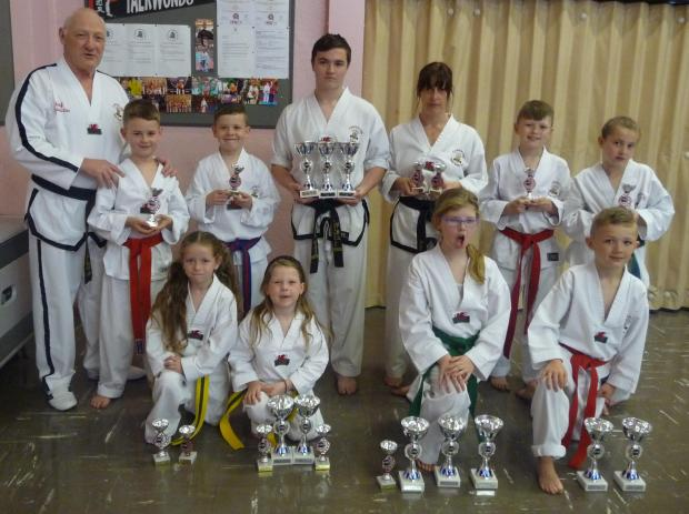 TROPHY TIME: Displaying trophies won at a WOMAA British Grand Prix tournament are students of the Cadoxton Schools of Taekwon-Do - Jake Quigley, Joel Wells, Bradley Halford, Anita Sheppard, Cian Allen Jessie Blackley, Maddison Allen, Thea Cunningham, Luci