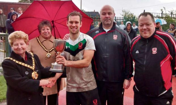 Barry And District News: WINNERS: The Vale Mayor Margaret Alexander and her Consort Jayne Norman presented the Barry Cup to Cowbridge captain Craig Burrows, assistant manager Paul Langford and manager Andy Pinchbeck