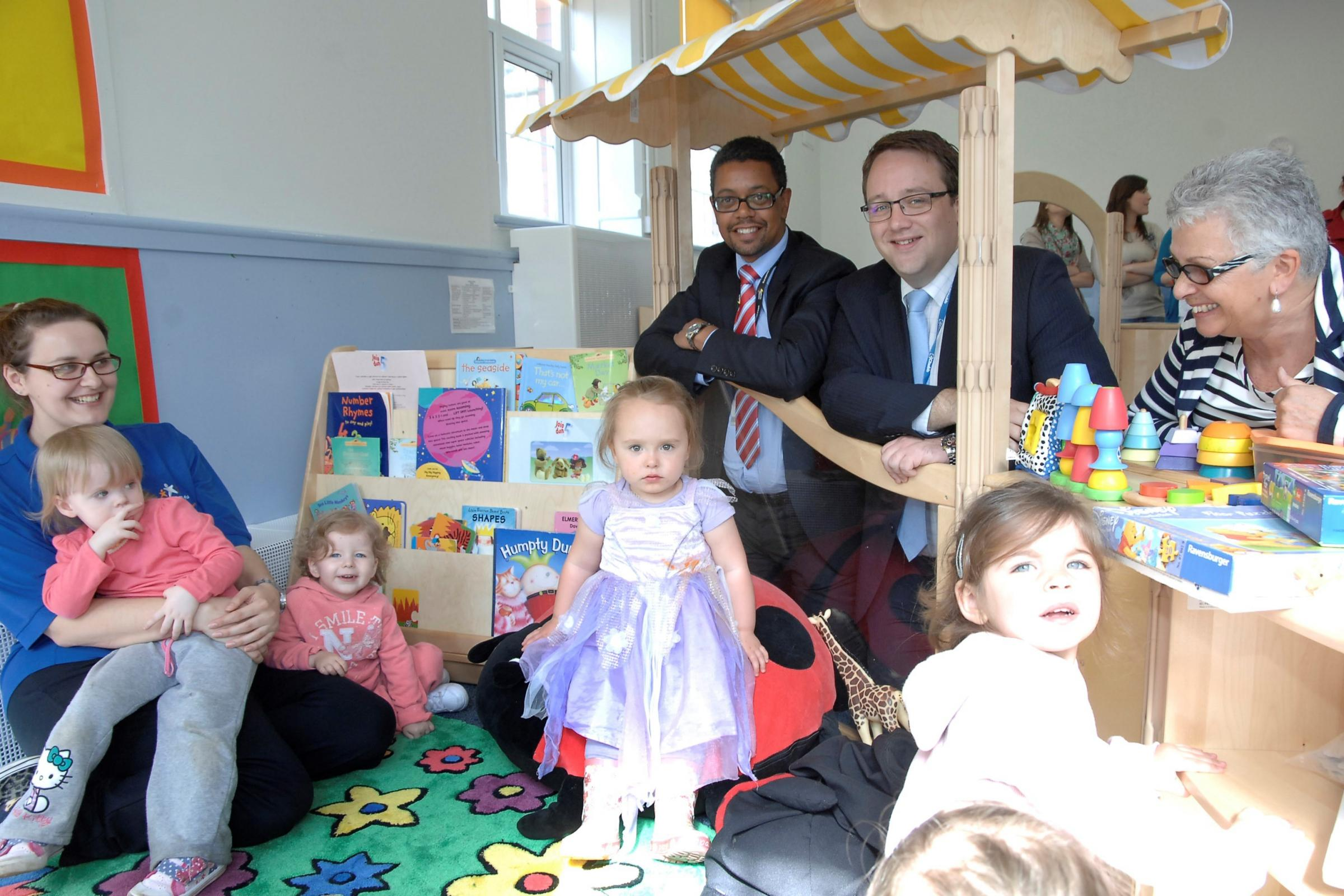 FLYING START: Vaughan Gething AM and Councillor Chris Elmore with staff and children at