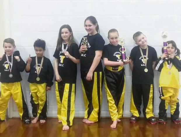 CHAMPIONSHIP SUCCESSES: Youngsters from the Barry Kickboxing Club were among the medals at their first WUMA British Championships.