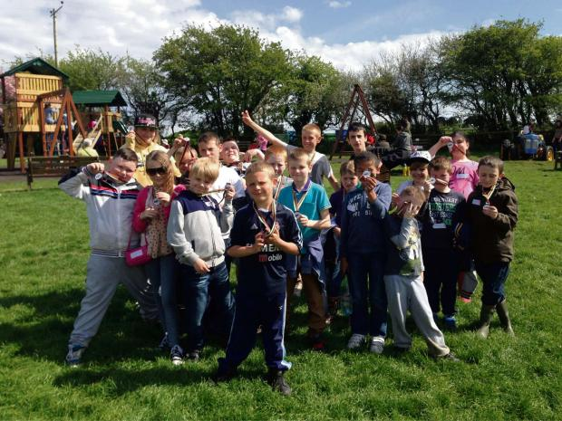 Barry And District News: EASTER CAMP: Children and young people enjoying their day out to the Amelia Trust Farm